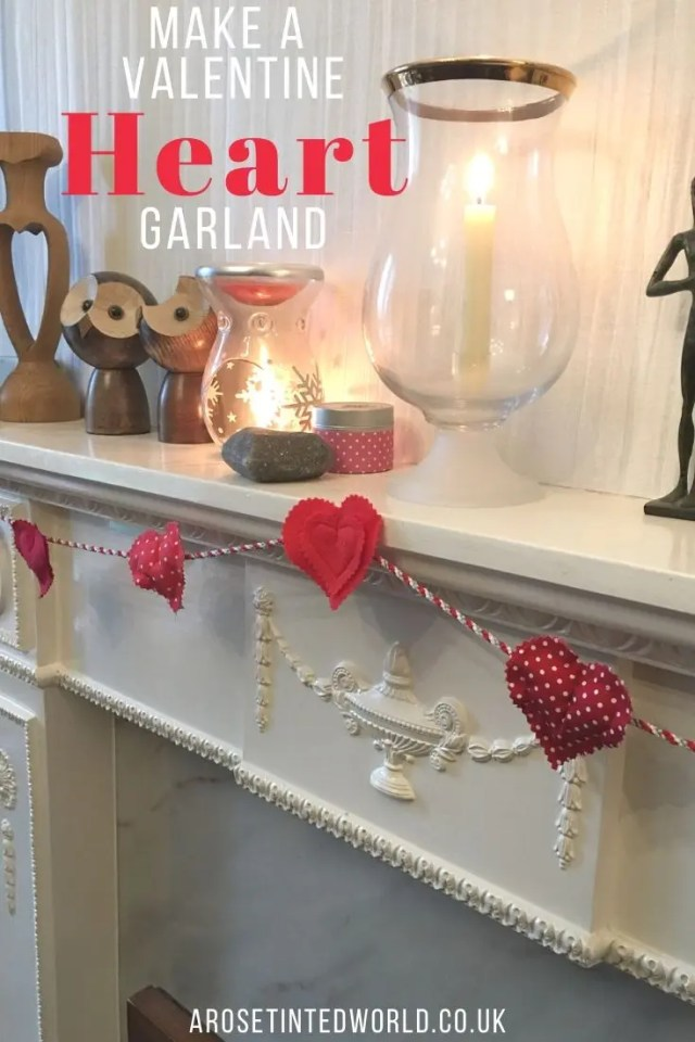 Padded Heart Valentine Garland - this pretty decor perfect for Valentine's day is really easy to make from fabric scraps. Find out in this tutorial how to make one for yourself. #valentinesday #valentinedecor #valentinegarland #heartdecor #valentinecrafts #valentinesdaydecorations #valentinedaycrafts #valentinedecorations #fabricscraps #heartcrafts #heartart