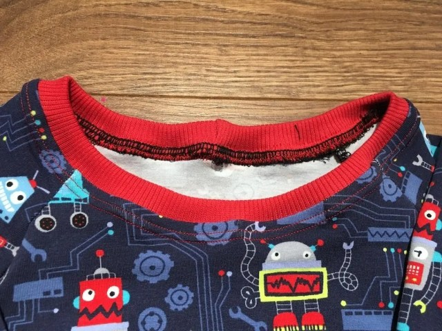 How To Sew A Neck Band Into A Stretch Garment - finished neck band sewn in and finished with a twin needle