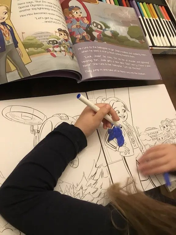 Elizabeth with the colouring book from the set