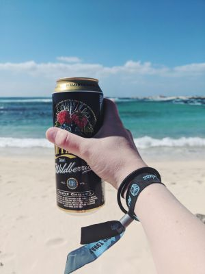 Drinking a cider on El Cotillo Beach