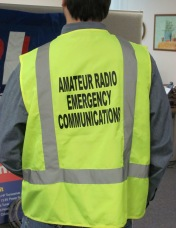 Ham radio operator wearing Amateur Radio Emergency Service safety vest