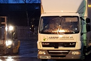 "img src=""Arrow-Couriers.jpg"" alt=""Arrow couriers truck in the rain at night"""