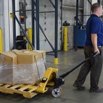"""img src=""""Arrow-Couriers-b2b-Delivery-experts.jpg"""" alt=""""Uniformed Arrow employee pulling sa pallet truck"""""""