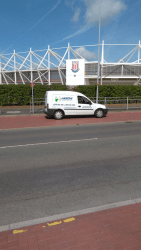"img src=""Stoke.png"" alt=""Arrow Couriers parked outside Stoke City Football Club"""