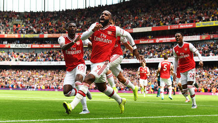 Alex Lacazette celebrates scoring against Burnley