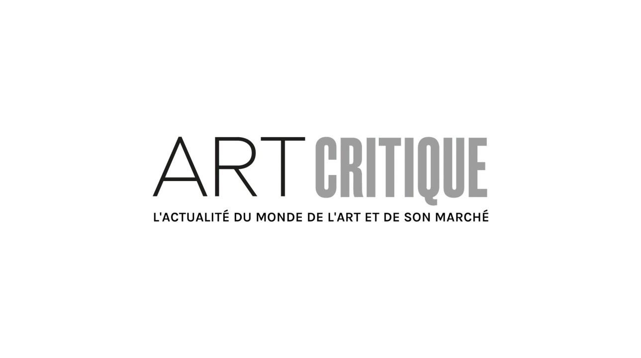 The creature and Victor Frankenstein shaking hands in National Theatre's Frankenstein