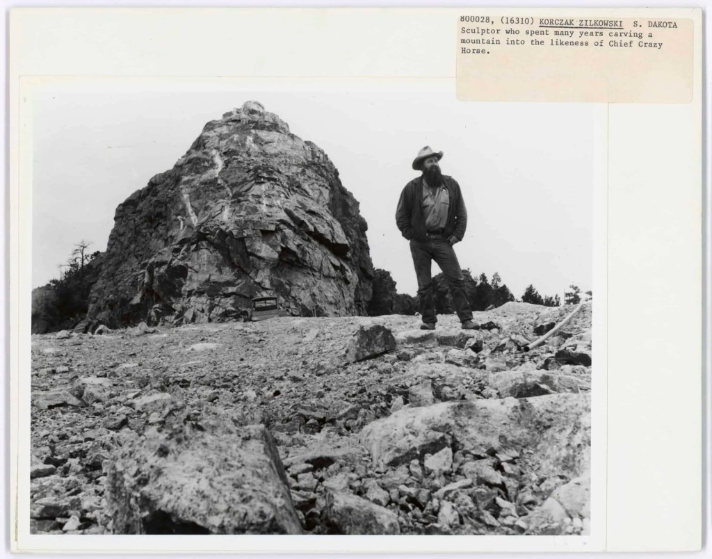 Korczak Ziolkowski stands in front of a mountain