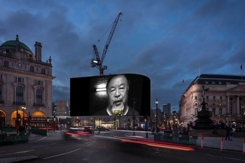 Image of artist Ai Weiwei in Piccadilly Circus Art World Rounup