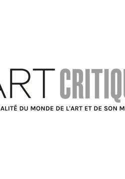 Black and white photo of Dutch artist Piet Mondrian in his Paris studio in 2913 with Pétro (Nelly) van Doesburg.
