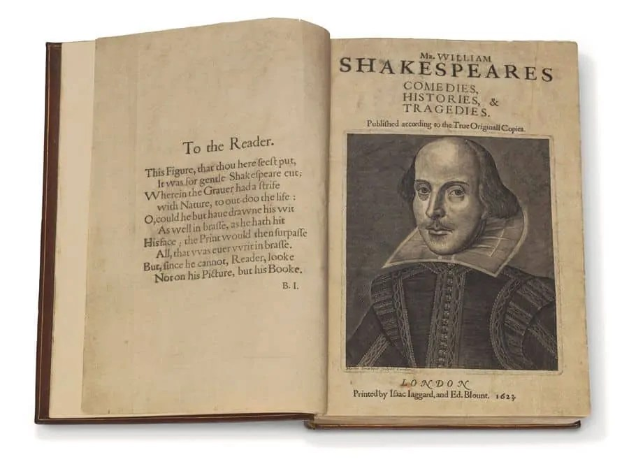 Open book of plays by William Shakespeare showing a fontispage with the writer's portrait printed in 1623.