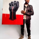 """Usher holds a red, white, and black artwork by James Jean for """"Show Me the Signs."""""""
