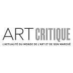 An artist crouches beside an artwork aboard a small boat Art World Roundup