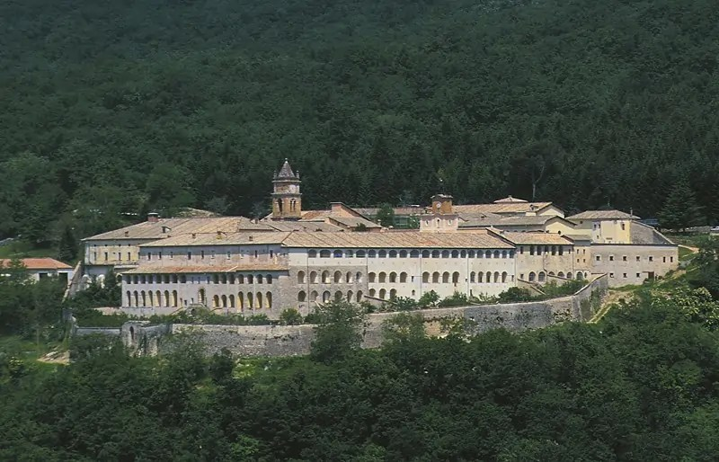 A photo of the Monastery of Trisulti amongst a forest Art World roundup