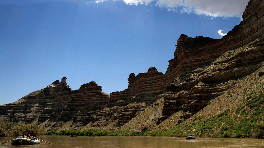 Floating on the river while whitewater rafting on the Green River in Desolation Canyon in Utah with ARTA river trips