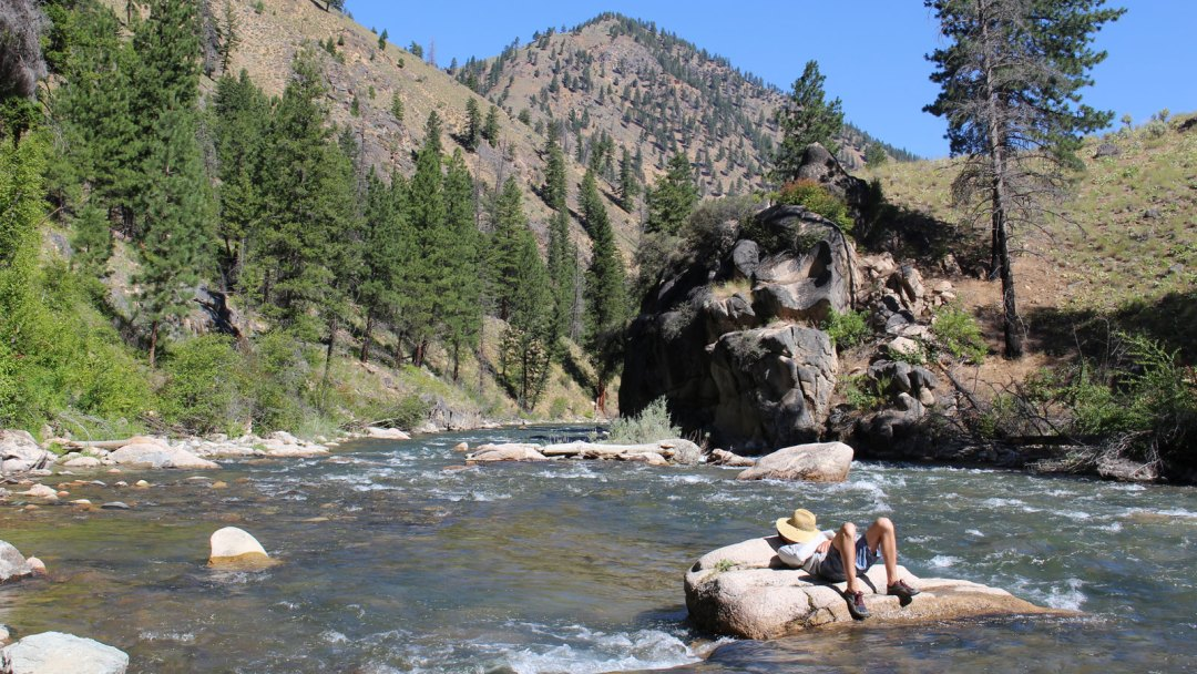 A rafter takes a break along the Middle Fork of the Salmon in Idaho