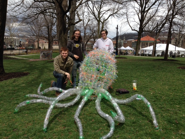 "Brad, Adam and Mandie installing ""Octopus,"" made of recycled plastic bottles."