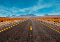 a ohoto of a road going into the desert