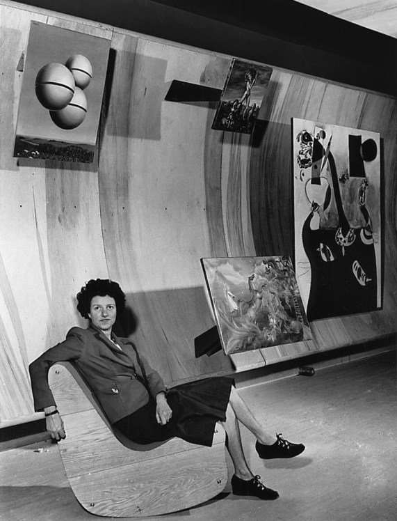 Peggy Guggenheim seated on a Correalist Rocker, Surrealist Gallery, Art of This Century, New York, ca. 1942