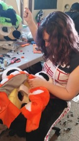MaryLynn sewing a tiger head.
