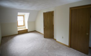 Bedroom #3 on the second floor has a window seat / storage bin and new carpeting