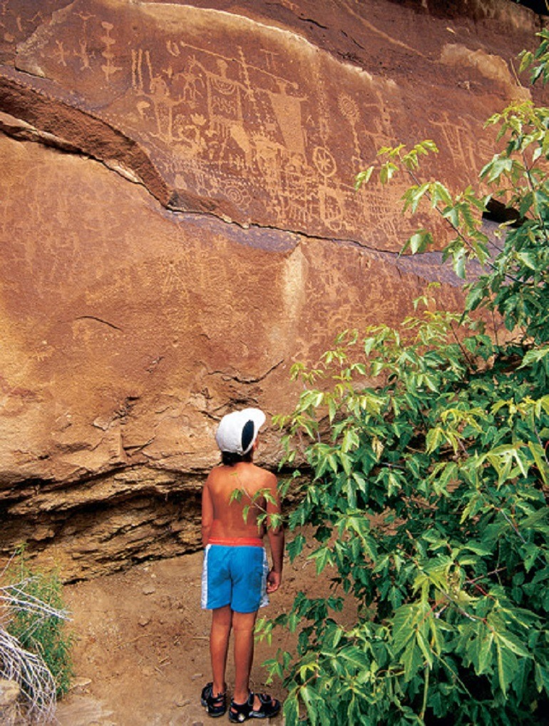 Image- Adventurous kids Discover Dinosaur Tracks and spectacular views of Native American Petroglyphs etched into rock on Potash Road