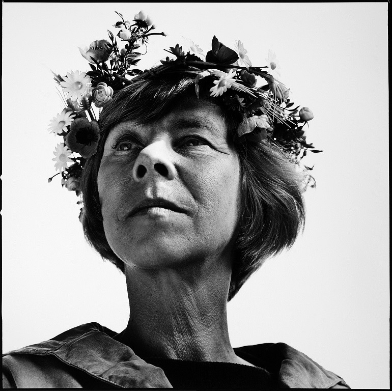 Image- Shows Tove Jansson, a Swedish-speaking Finnish novelist, painter, artist, illustrator and comic strip author. In the image by Hans Gedda, a professional photographer , Tove Jansson is dressed like a nymph