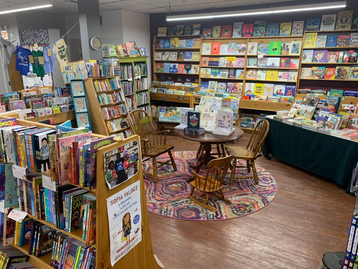 A cozy reading area surrounded by books, arranged by an independent bookseller at a bookstore
