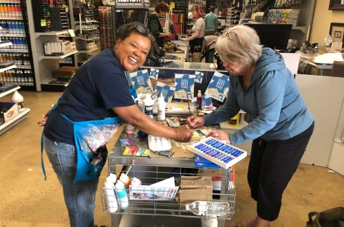 Demo artist at art supply store working with a happy customer!