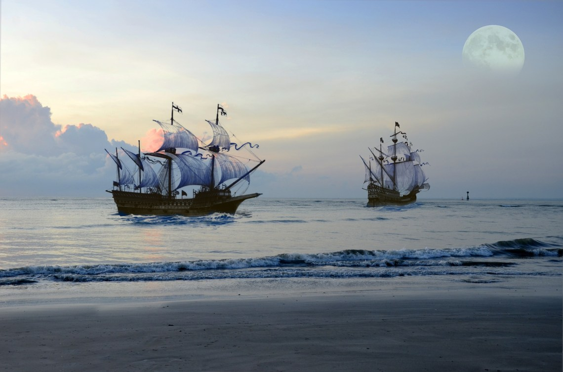 Pirate ships at sea with the moon in the sky for a dreamy landscape