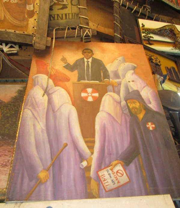 obama surrounded by the ku klux klan