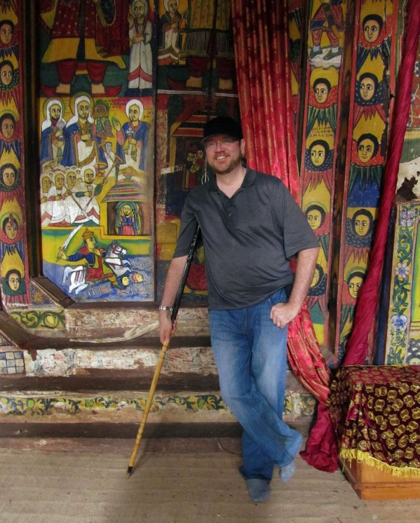 dave lafontaine posing with the crutch-chairs in the bahir dar monasteries