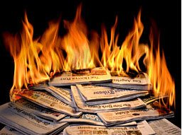 pile of newspapers on fire
