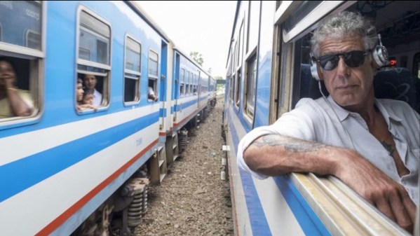 anthony bourdain on a train
