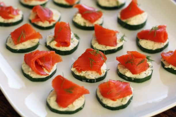 A Platter of Elegant Cucumber Bites with Herbed Cheese and Smoked Salmon