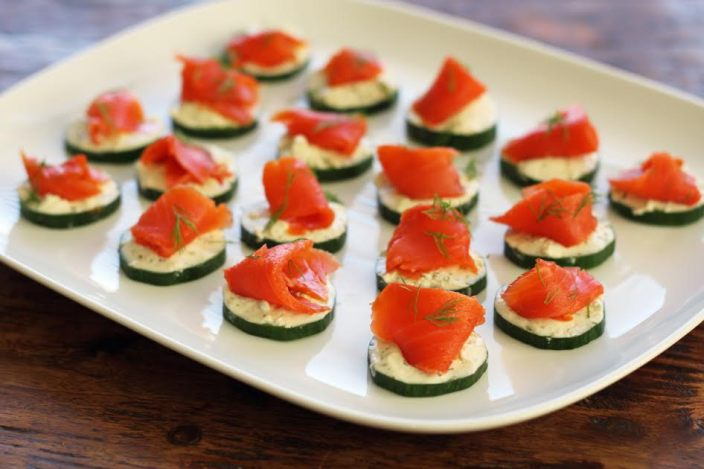 A Platter of Elegant Cucumber Bites with Herbed Cheese and Smoked Salmon Three Ingredient Appetizer | www.artfuldishes.com