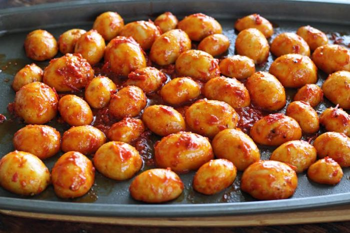 Place the Harissa Potatoes Cut Side Down on the Baking Sheet | artfuldishes.com