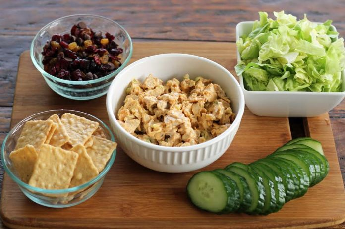 Ingredients Assembled for Chicken Salad Protein Boxes Lettuce Cucumbers Crackers Dried Fruit | artfuldishes.com