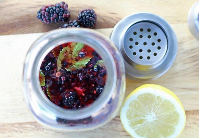 Blackberry Smash Bourbon Cocktail - Muddling the Blackberries and Mint | www.artfuldishes.com