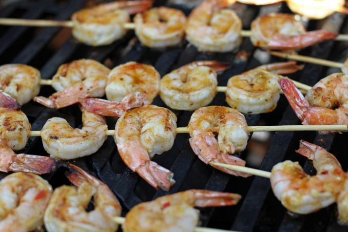 Adding the Sweet Chili Sauce to Glaze the Sweet Chili Glazed Grilled Shrimp Skewers | www.artfuldishes.com
