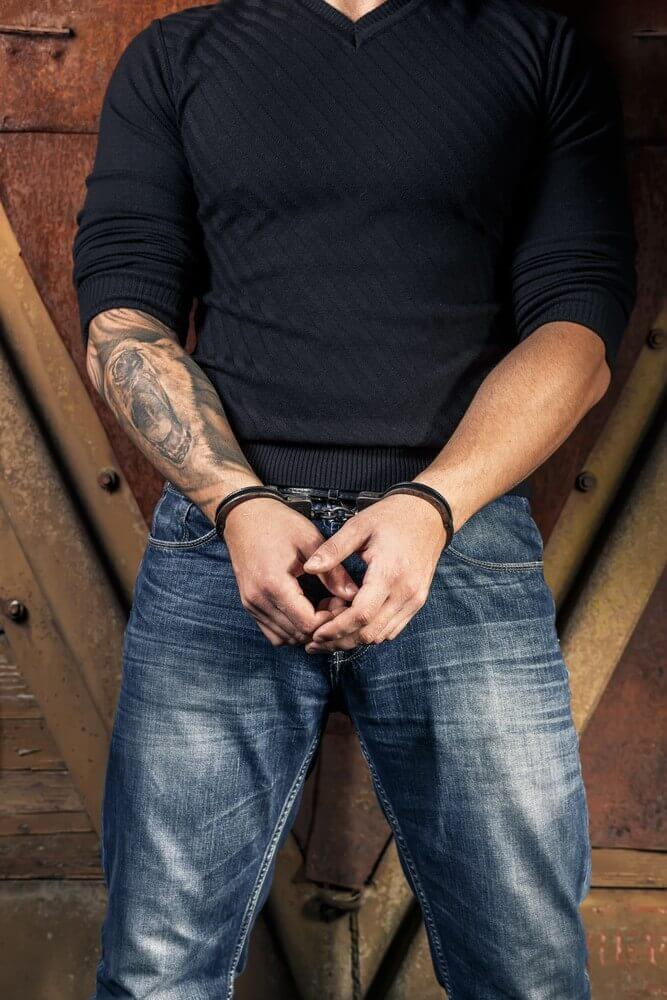 Tattooed hands of a criminal - How To Remove Tattoos Naturally