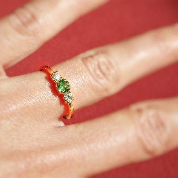 yellow gold ring, with a brilliant cut tsavorite (green garnet) and two brilliant cut diamonds.