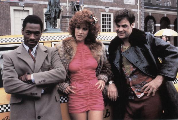 Dan Aykroyd , Eddie Murphy , Jamie Lee Curtis Directed by John Landis