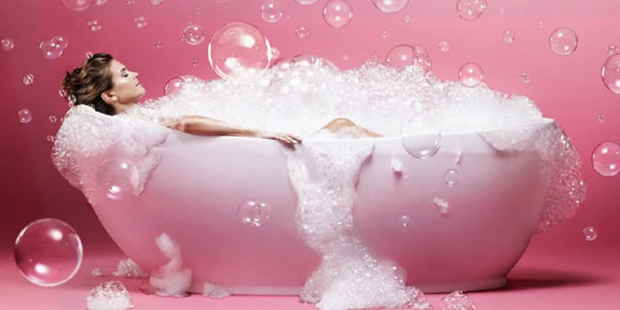 A woman enjoying a bubble bath, (National Days).