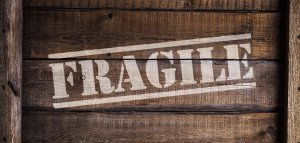 The word fragile written on a wooden crate.