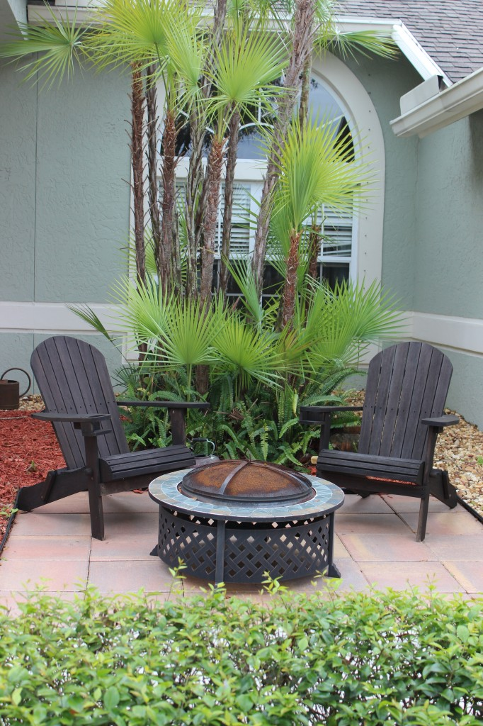 Create A Seating Area With Adirondack Chairs And A Fire Pit