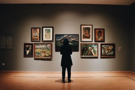 A person admiring valuable art in a gallery