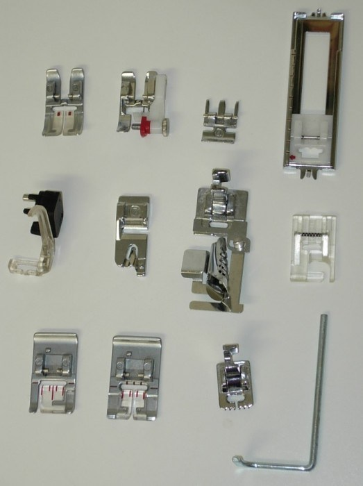 A selection of presser feet and accessories for a Pfaff Creative Sewing Machine