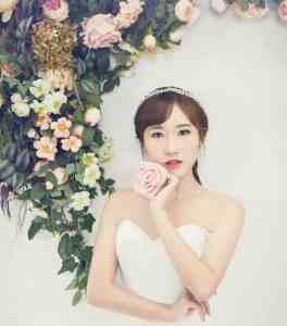 Bride holding rose