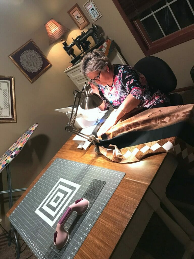 Corinne Arnold quilting in her South Dakota home
