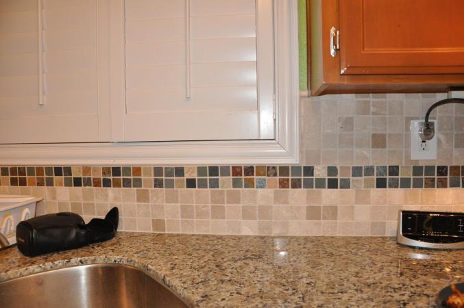 Golden Butterfly Kitchen With MosaicTile Backsplash